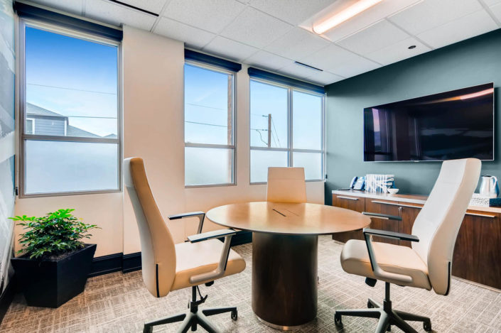 Boulder Office round table with chairs and mounted monitor