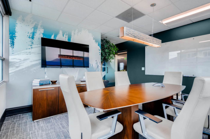 Conference table with wall art boulder interior design