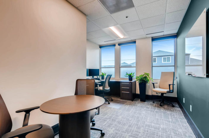meeting table with chairs in personal office boulder