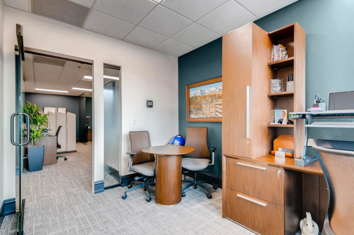 Personal Office in boulder with meeting desk and Wall Art