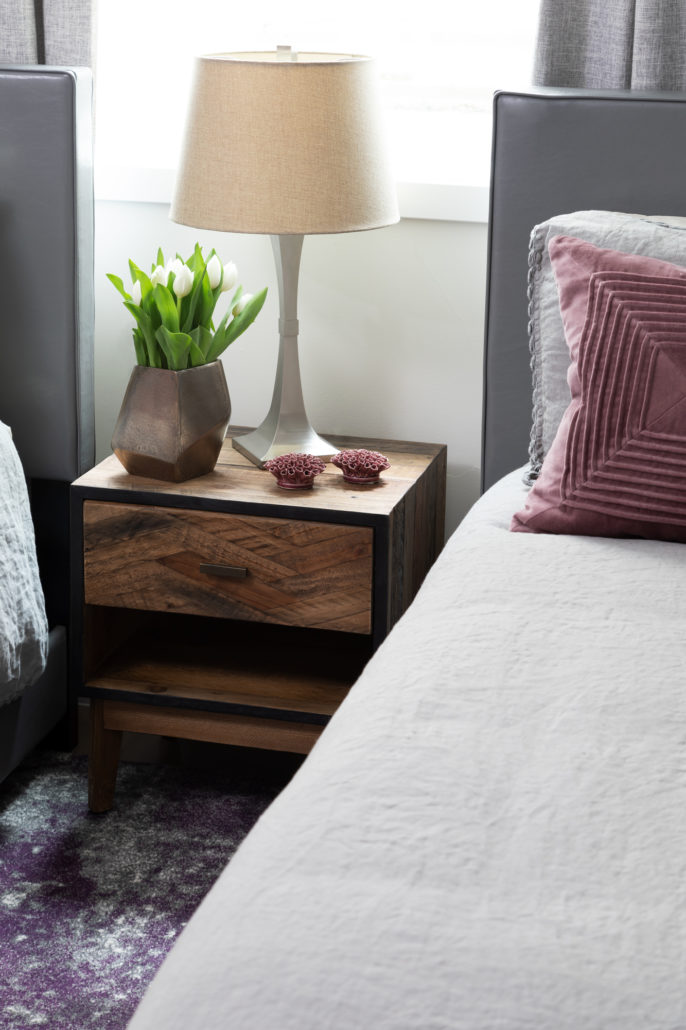 wooden bedside table with lamp