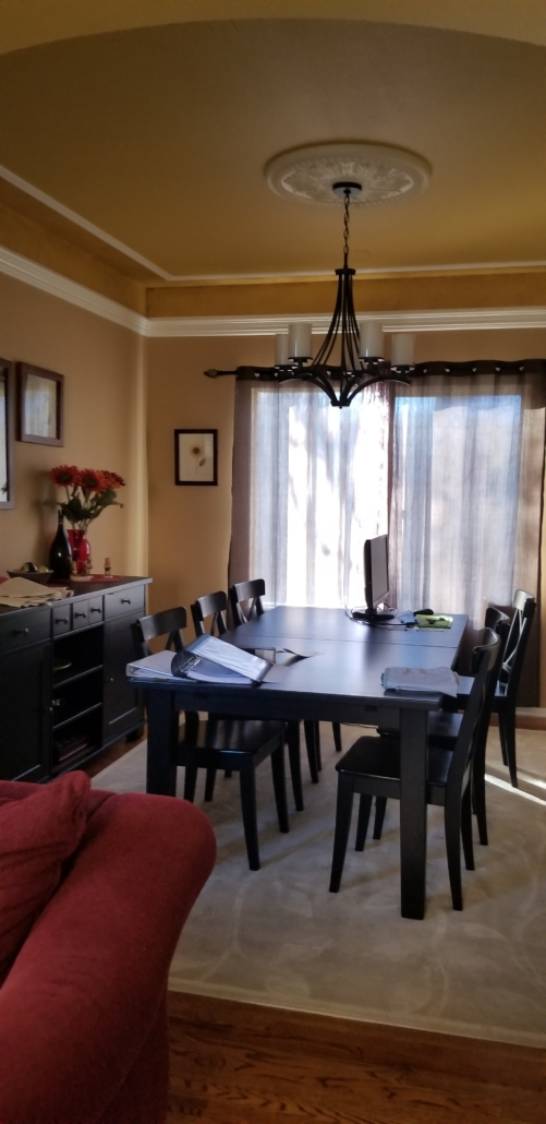 dining room with orange walls and old lighting fixture