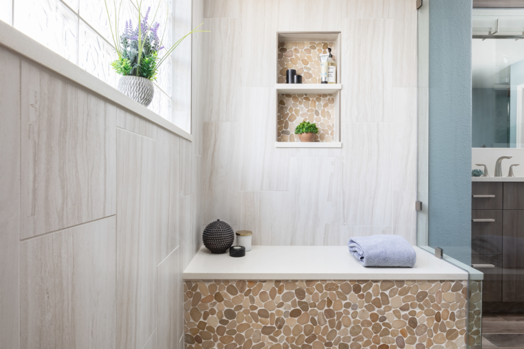 Bathroom shower remodeled with bench and shelf space