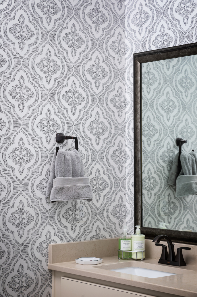 elegant bathroom sink and mirror design with custom wallpaper