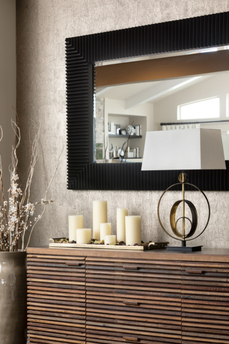 Wallpaper with complementing drawers, lamp and mirror
