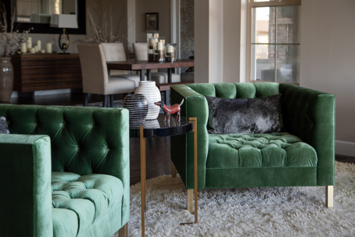Pair of green chairs with decorative sidetable