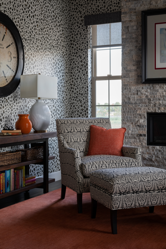 Longmont wallpaper and window coverings next to chair and bookshelf
